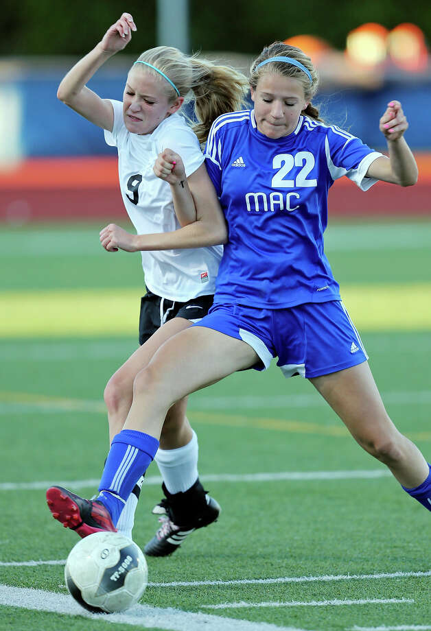 Steele's Emily Helgren (left) and MacArthur's Kyra Falcone struggle for control of the ball during second half action of their Class 5A second round playoff game on April 4, 2013 at Orem Stadium. Photo: Edward A. Ornelas /San Antonio Express-News / © 2013 San Antonio Express-News