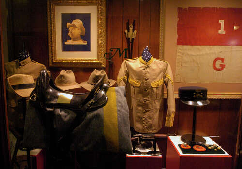 This is a display about Teddy Roosevelt and the Roughriders and the Spanish American War. Many of the artifacts are believed to have actually been used during the charge on San Juan Hill. Photo: John Davenport / San Antonio Express-News / SAN ANTONIO EXPRESS-NEWS