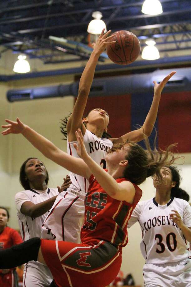Roosevelt's Jasmine Villanueva goes high above Lee's Lauren Fritscher (15) for a rebound during the Rider's 50-34 home win Friday, Jan. 23, in front of teammates Monique Lipscomb (left) and Aliyah Christmas (30). Photo: Greg Bell / For The Northeast He