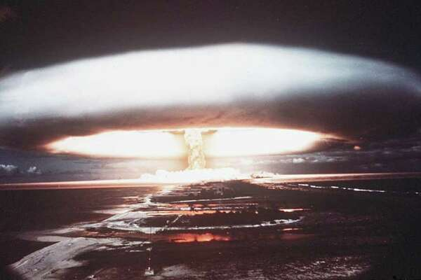 (FILES) A picture taken in 1971 shows a nuclear explosion in Mururoa atoll. France said on March 24, 2009 it will compensate 150,000 victims of nuclear testing carried out in the 1960s in French Polynesia and Algeria, after decades of denying its responsibility. An initial sum of 10 million euros (14 million dollars) has been set aside for military and civilian staff as well as local populations who fell ill from radiation exposure, Defence Minister Herve Morin told Le Figaro newspaper. AFP PHOTO FILES / STRINGER