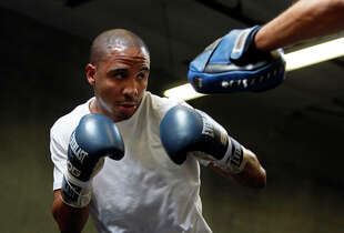 Super middleweight champion Andre Ward works out with trainer Virgil Hunter last year at his private gym in Hayward.