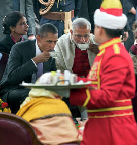 RETRANSMISSION TO OFFER ALTERNATE CROP --  President Barack Obama and Indian Prime Minister Narendra Modi, center, have tea during a reception at the Mughal Gardens of Rashtrapati Bhavan in New Delhi, Jan. 26, 2015. Obama's decision to accept the invitation to be chief guest during India's Republic Day celebration has been seen here as a great tribute to India, heralded by politicians and the news media as a sign of the country's importance on the world stage. (Stephen Crowley/The New York Times)