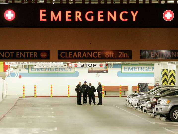 Security guards stand outside of the ambulance entrance to the at the UCLA Medical Center emergency