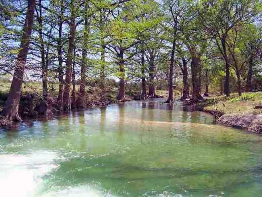 Address:5134 CR 473Acreage: 54 acres Water: Little Blanco River  Frontage: CR 473 HOA: None Amenities: Two  water crossings, two TXDOT approved entrances, mature oak, pecan and  cypress trees, lots of wildlife, multiple home sites, river bisects  property