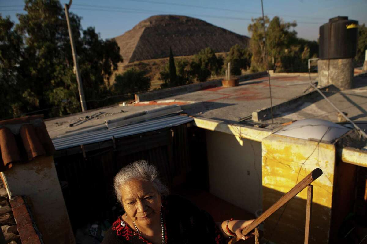 Emma Ortega, a spiritual healer who cares for patients across from the Pyramid of the Moon, views Walmart as a threat to Mexico's cultural traditions.