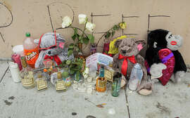A memorial on McAllister Street pays tribute to a victim of the Jan. 9 quadruple homicide.