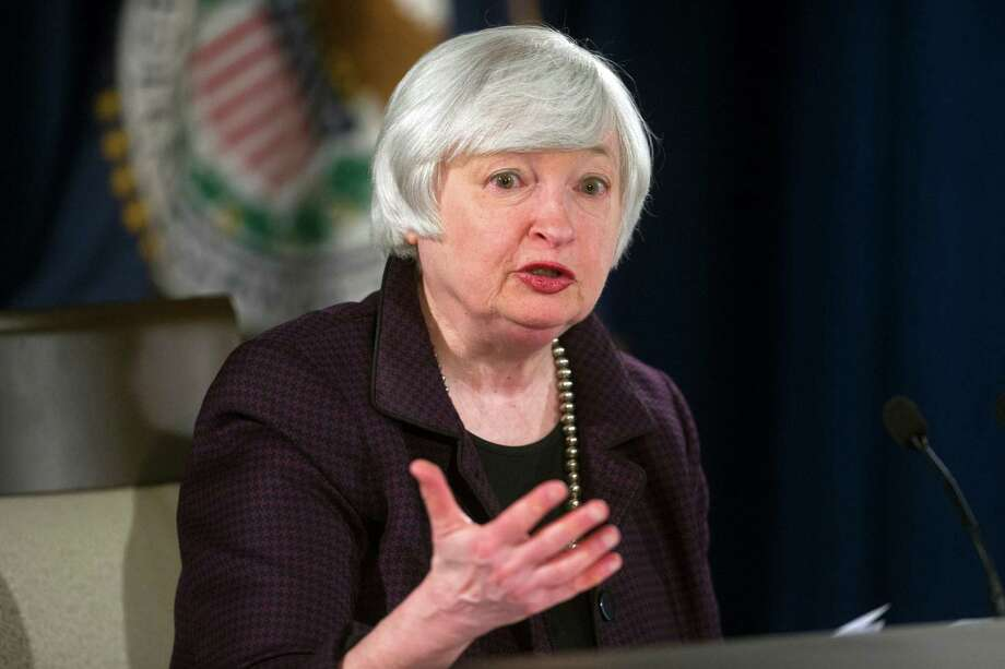 """FILE - In this Dec. 17, 2014 file photo, Federal Reserve Chair Janet Yellen speaks with reporters at the Federal Reserve in Washington. The Federal Reserve ended 2014 with a pledge to be """"patient"""" in raising interest rates from record lows. The way things are going, its patience may endure for a long while. (AP Photo/Cliff Owen, File) Photo: Cliff Owen, FRE / FR170079 AP"""