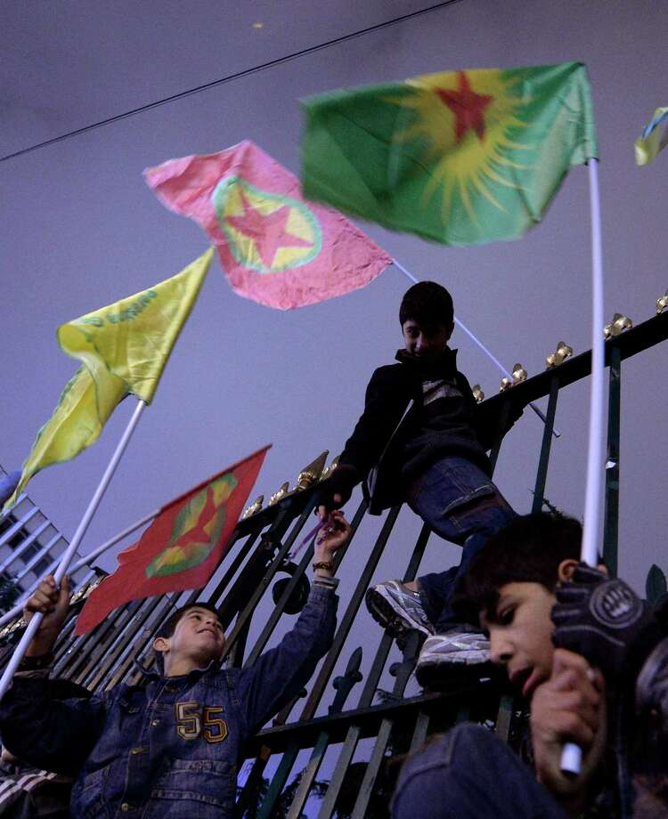 Kurds wave flags of the outlawed Kurdistan Workers' Party to celebrate in Istanbul on Monday after Kurdish fighters, backed by U.S.-led airstrikes, pushed the Islamic State group out of Kobani. Photo: STR / STR