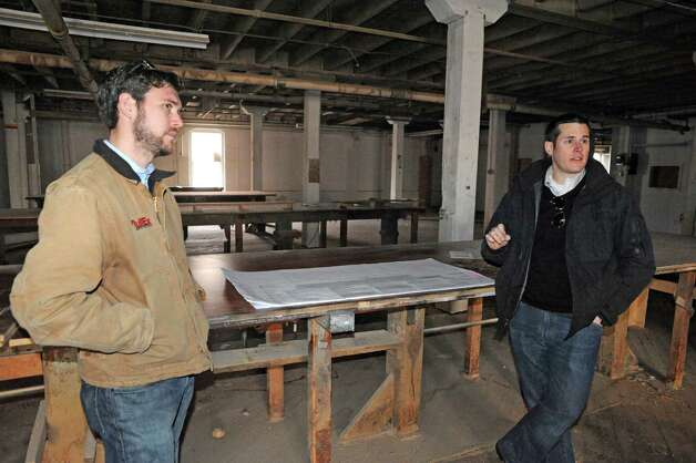 John Blackburn, left, and Tom Rossi at the former Tilley Ladder Company Wednesday Jan. 21, 2015, in Watervliet, N.Y. They plan to develop the property into loft apartments. (Michael P. Farrell/Times Union) Photo: Michael P. Farrell / 00030263A