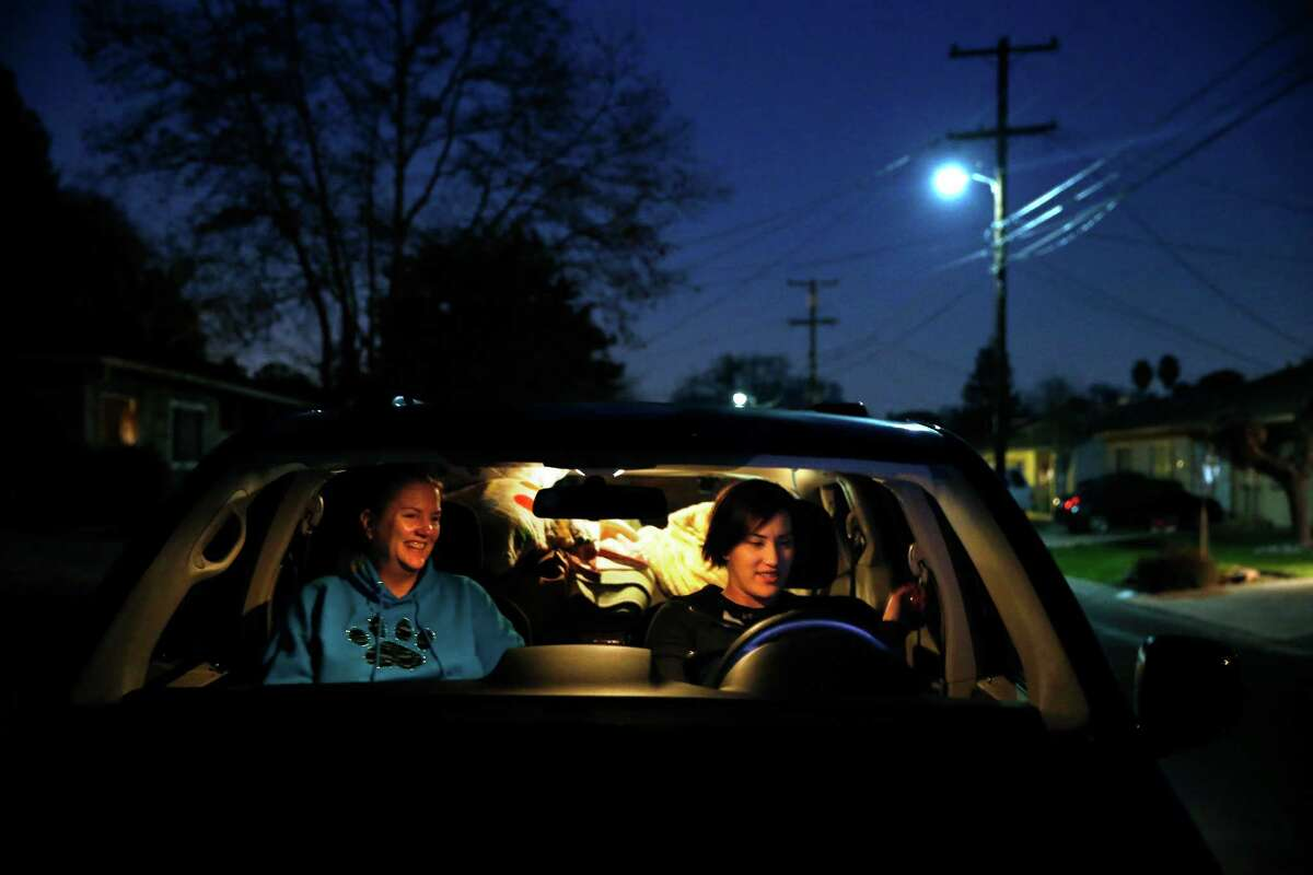 On their way to pick up a rescue dog in Discovery Bay, Stefani Buzzard (right) and Beth Bennett prepare to leave Buzzard's home in Concord.