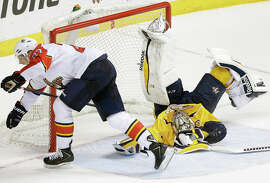 """At times, Nashville's Pekka Rinne seems to take the hockey term """"standing on his head"""" literally."""