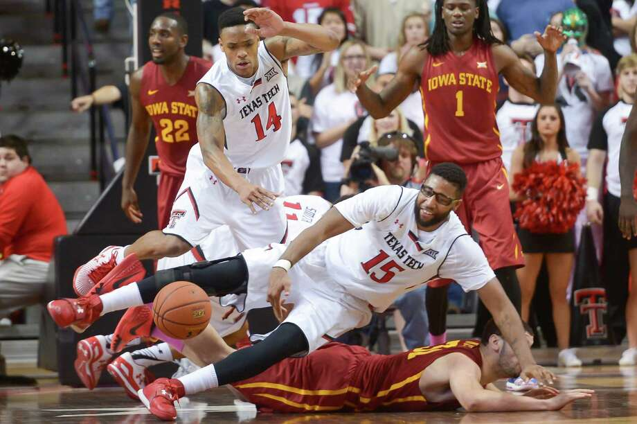 Texas Tech's Robert Turner (14) and Aaron Ross (15) battle Iowa State's Georges Niang (on floor) for a loose ball on Jan. 24, 2015, at the United Supermarkets Arena in Lubbock. Texas Tech defeated Iowa State 78-73. Photo: John Weast /Getty Images / 2015 Getty Images