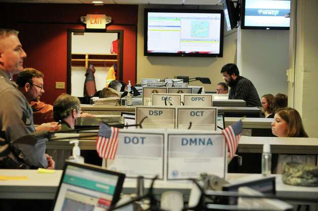 Employees of Federal and New York State agencies work on storm planning inside the State's Emergency Operations Center on Monday, Jan. 26, 2015, in Albany, N.Y.  (Paul Buckowski / Times Union) Photo: Paul Buckowski / 00030347A