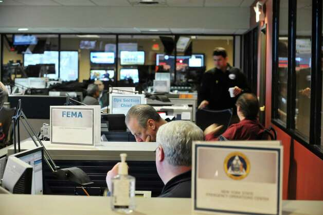 Employees of Federal and New York State agencies work on storm related issues inside the State's Emergency Operations Center on Monday, Jan. 26, 2015, in Albany, N.Y.  (Paul Buckowski / Times Union) Photo: Paul Buckowski / 00030347A