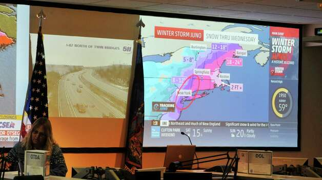 Large screens show news program feeds and traffic cameras as employees of Federal and New York State agencies work on storm related issues inside the State's Emergency Operations Center on Monday, Jan. 26, 2015, in Albany, N.Y.  (Paul Buckowski / Times Union) Photo: Paul Buckowski / 00030347A