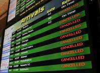 The monitor showing arrival flights at the Albany International Airport is full of cancellations on Monday, Jan. 26, 2015, in Albany, N.Y.  (Paul Buckowski / Times Union)