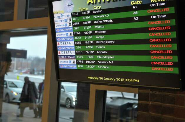 The monitor showing arrival flights at the Albany International Airport is full of cancellations on Monday, Jan. 26, 2015, in Albany, N.Y.  (Paul Buckowski / Times Union) Photo: Paul Buckowski / 00030347A
