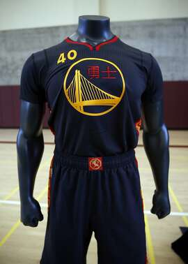 The Golden State Warriors unveil the team's first ever Chinese New Year uniform at the Betty Ong Rec Center in San Francisco, Calif. on Monday, January 26, 2015.