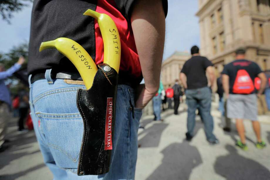 """Jason Green wears a holster with bananas marked """"Smith"""" and """"Wesson"""" at a rally in support of open carry gun laws Monday at the Capitol in Austin. Photo: Eric Gay, STF / AP"""
