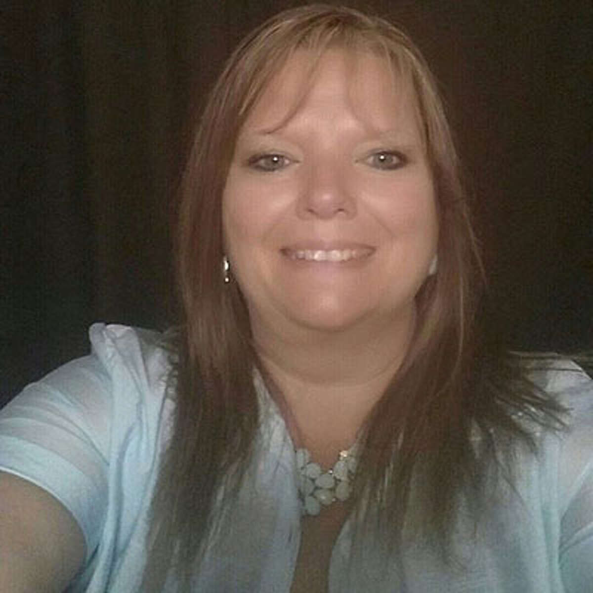 Angela Porter Russell, 45, whose body was found in a field in Liberty County over the weekend. Her husband has been charged in Montgomery County with murder in her death.