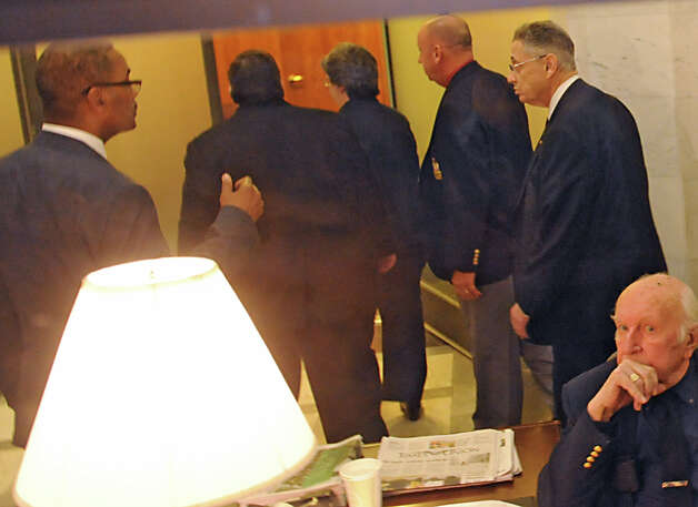Speaker Sheldon Silver, right, walks into a meeting with the Assembly members at the Capitol on Monday, Jan. 26, 2015 in Albany, N.Y.(Lori Van Buren / Times Union) Photo: Lori Van Buren / 00030344A