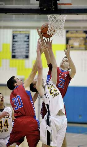 Liam Lajeunesse, left, and Dean Kohanek, right, of South Glens Falls and Jordan Yearsley of Averill Park battle for a rebound during their game on Monday night, Jan. 26, 2015, in Averill Park, N.Y.   (Paul Buckowski / Times Union) Photo: Paul Buckowski / 00030314A