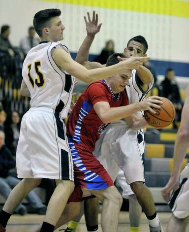 Lukas Morgan, left, and Isaiah Moak, right, of Averill Park try to stop Dean Kohanek of South Glens Falls during their game on Monday night, Jan. 26, 2015, in Averill Park, N.Y.   (Paul Buckowski / Times Union) Photo: Paul Buckowski / 00030314A