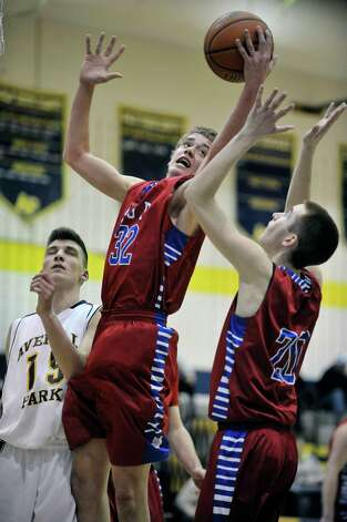 Connor Stone, center, and Connor Kuebler of South Glens Falls go for a rebound during their game against Averill Park on Monday night, Jan. 26, 2015, in Averill Park, N.Y.   (Paul Buckowski / Times Union) Photo: Paul Buckowski / 00030314A