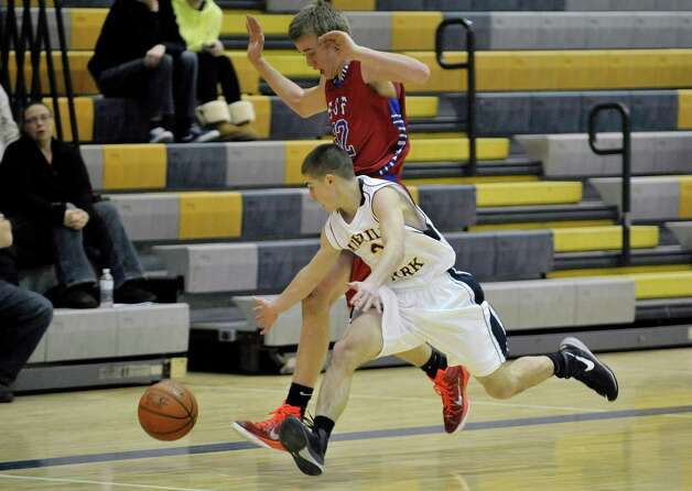 D.J. Morone, foreground, of Averill Park and Connor Stone of South Glens Falls chase a loose ball during their game on Monday night, Jan. 26, 2015, in Averill Park, N.Y.   (Paul Buckowski / Times Union) Photo: Paul Buckowski / 00030314A