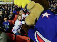 Mia Lopata, 11, of Clinton, reaches for the Rochester Americans' Moose during the AHL All-Star Classic at the Utica Memorial Auditorium, Jan. 26, 2015, in Utica, N.Y. (AP Photo/Observer-Dispatch, Mark DiOrio) ORG XMIT: NYUTI110