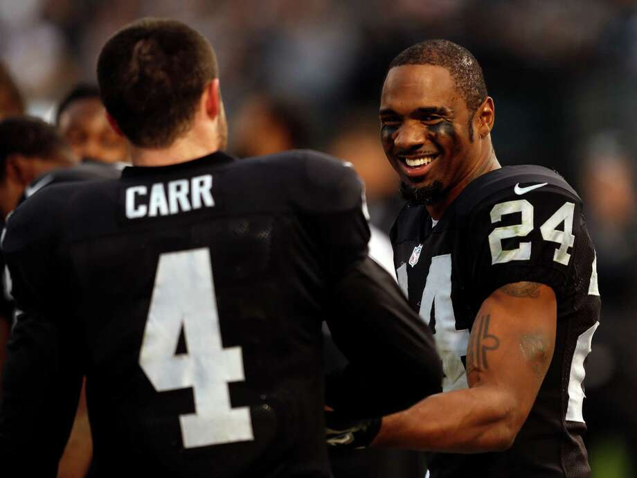 Raiders safety Charles Woodson will return for his 18th NFL season after signing a one-year deal and avoiding free agency. Woodson led Oakland with 160 tackles this season. Photo: Scott Strazzante, Staff Photographer / ONLINE_YES