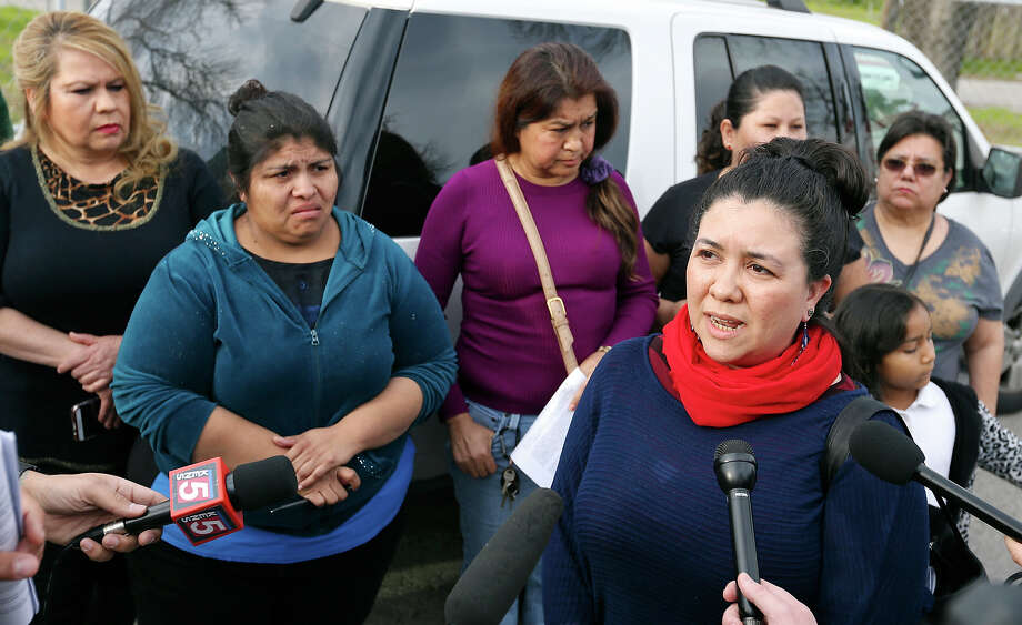 Jessica Guerrero, Fuerza Unida community organizer, (right center) answers questions from the media as current and former Mission Trails Mobile Home Community residents listen Monday Jan. 26, 2015 at the Mission Trails Mobile Home Community. Photo: Edward A. Ornelas, Staff / San Antonio Express-News / © 2015 San Antonio Express-News