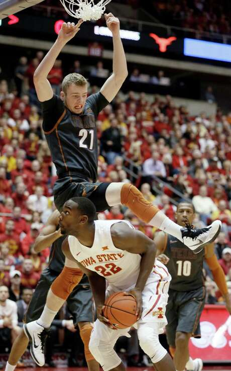 Iowa State's Dustin Hogue ducks under Texas' Connor Lammert (21) and eyes the basket during the Cyclones' 89-86 victory Monday night. Photo: Charlie Neibergall, STF / AP