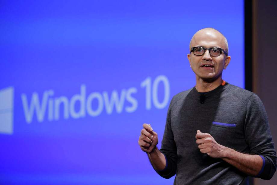 Microsoft CEO Satya Nadella  speaks at an event demonstrating new features of its flagship operating system Windows at the company's headquarters Wednesday, Jan. 21, 2015, in Redmond, Wash. Executives demonstrated how they said the new Windows is designed to provide a more consistent experience and a common platform for software apps on different devices, from personal computers to tablets, smartphones and even the company's Xbox gaming console. (AP Photo/Elaine Thompson) Photo: Elaine Thompson, STF / AP