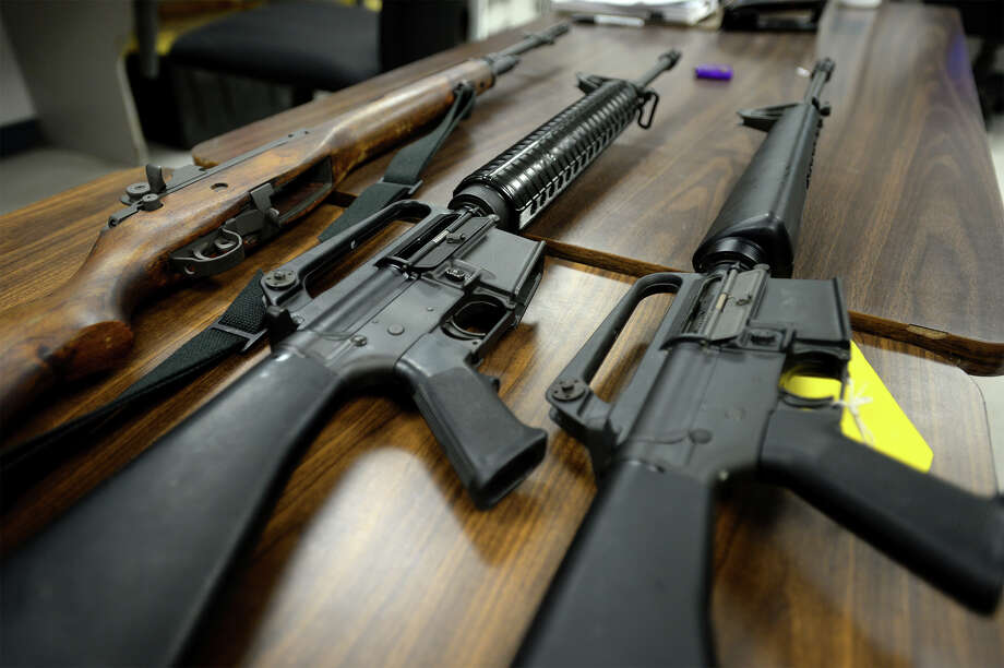 A M14, left, and two M16's lie on a table at the Vidor Police station in this file photo. Photo: Guiseppe Barranco, Photo Editor