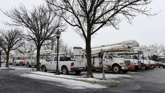 A large number of National Grid vehicles waited at The Desmond in Colonie on Tuesday awaiting orders on where they might be needed to restore electrical service. Crews at the scene said they were preparing for the possibility of being sent to the Boston area where the storm was most powerful. (Skip Dickstein / Times Union)