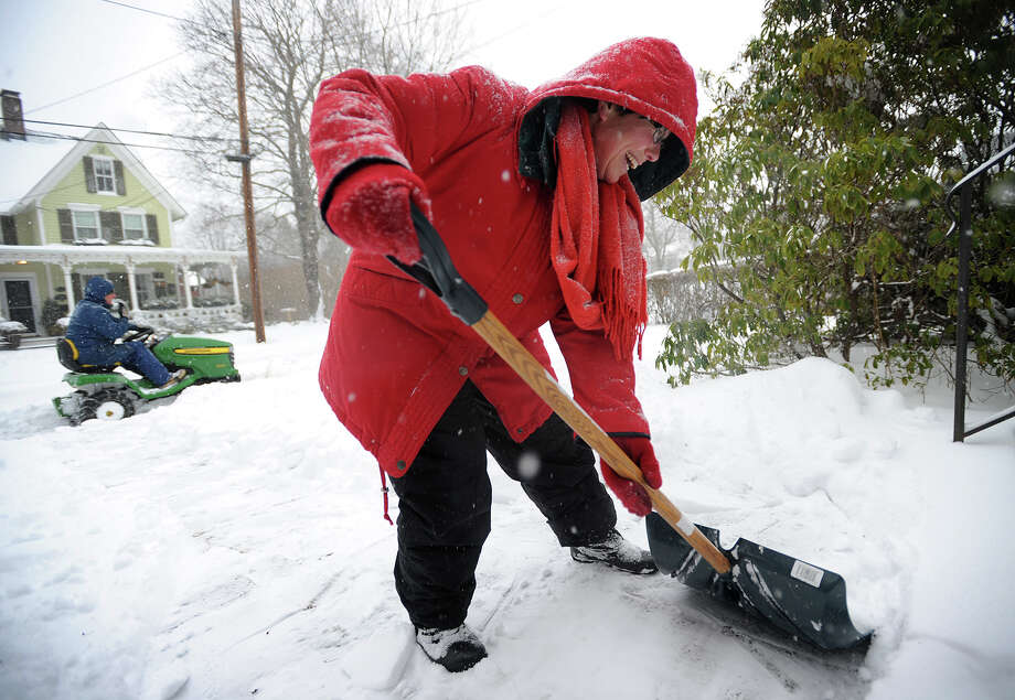 Robbie Silver and her husband Bill clear snow from in front of their Governors Avenue home in Milford, Conn. on Tuesday, January 27, 2015. Photo: Brian A. Pounds / Connecticut Post