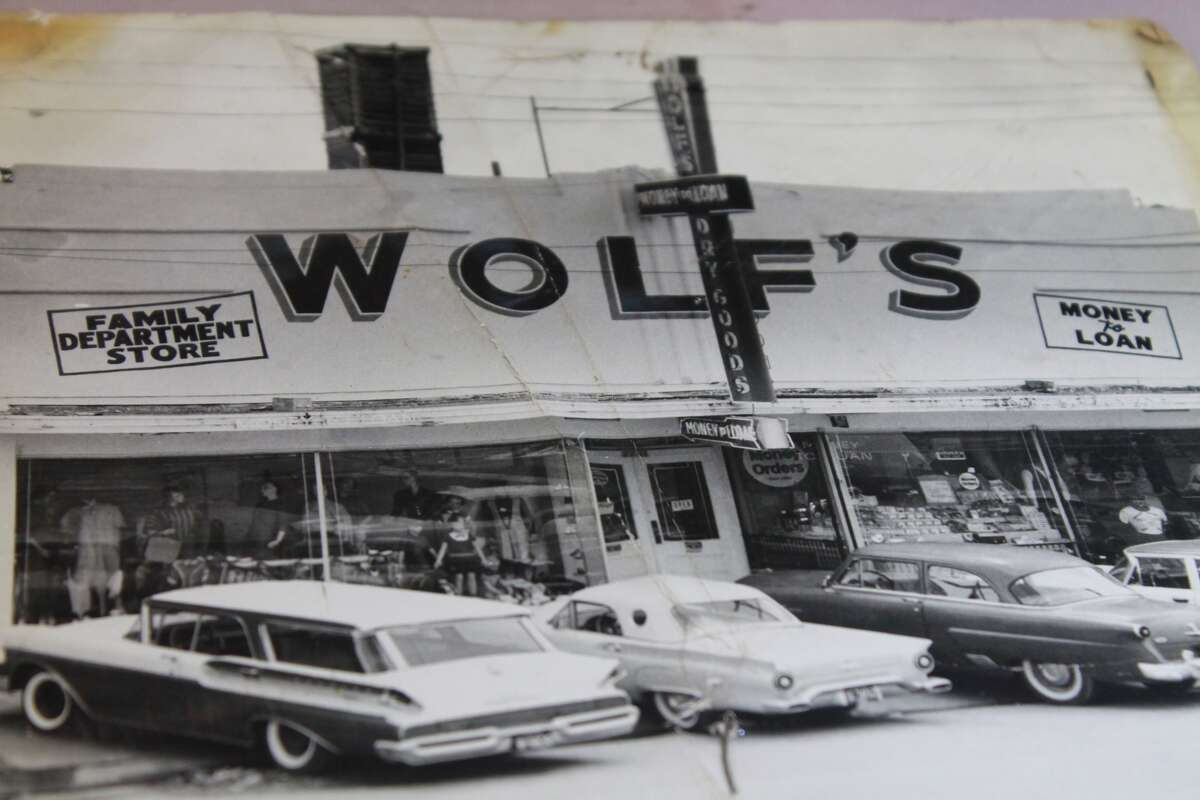Old photos show how the storefront of Wolf's used to look.