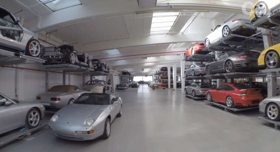 The warehouse stores its priceless contents 'Costco' style, with cars like this early 1990s 968 convertible parked in the aisle alongside racks of 911 and 944 sports cars. Photo: Car Magazine/Business Insider