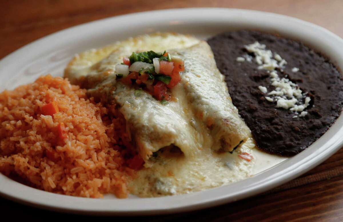 The Spinach and Mushroom Enchiladas with poblano cream score a home run at Moderno Tacos & Tex-Mex.