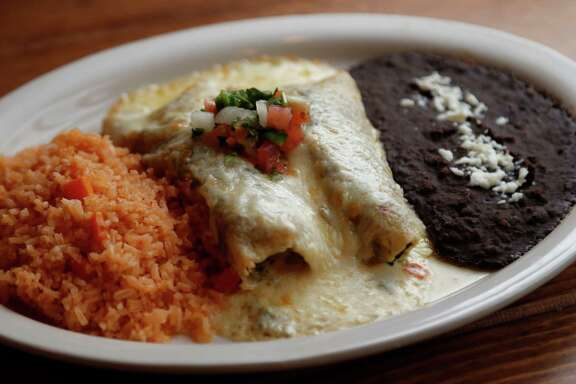 The Spinach and Mushroom Enchiladas with poblano cream score a home run at Moderno Tacos & Tex-Mex.