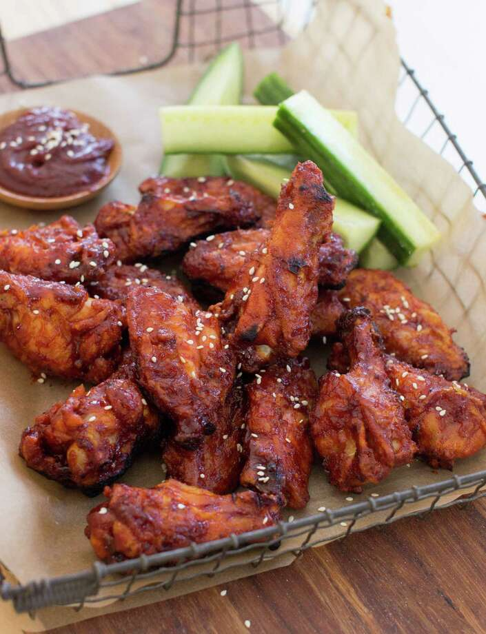 This Dec. 15, 2014 photo shows Korean style chicken wings in Concord, N.H. These wings are made with gochujang, which in Korean cooking is used as a base for stews and marinades, as well as a feisty condiment for one-pot dishes such as bibimbap. (AP Photo/Matthew Mead) Photo: Matthew Mead, FRE / FR170582 AP