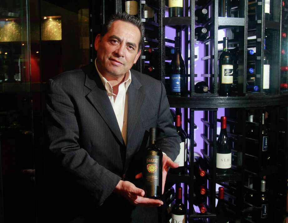 Frank Ramirez, at the Mr. Peeples wine tower, with a Faust 2011 Cabernet Sauvignon Napa Valley. He is the manager of the restaurant. (For the Chronicle/Gary Fountain, January 23, 2015) Photo: Gary Fountain, Freelance / Copyright 2015 by Gary Fountain