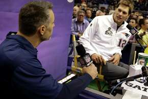 New England Patriots' Tom Brady talks to former NFL quarterback Kurt Warner during media day for NFL Super Bowl XLIX football game Tuesday, Jan. 27, 2015, in Phoenix. (AP Photo/Mark Humphrey)