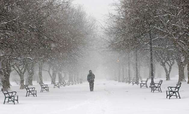 A man walks through Washington Park in a snow storm on Tuesday, Jan. 27, 2015 in Albany, N.Y. (Lori Van Buren / Times Union) Photo: Lori Van Buren
