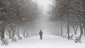 A man walks through Washington Park in a snow storm on Tuesday, Jan. 27, 2015 in Albany, N.Y. (Lori Van Buren / Times Union)
