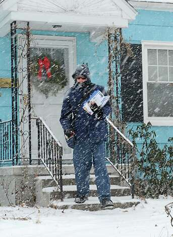 Mail carrier Rick Seebode of Albany delivers mail to homes on Hillcrest Ave. in a snow storm on Tuesday, Jan. 27, 2015 in Albany, N.Y. (Lori Van Buren / Times Union) Photo: Lori Van Buren