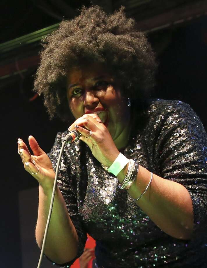 Lead singer, Kam Franklin and the band The Suffers perform on Friday, December 19, 2014 at Warehouse Live in In Houston, TX.