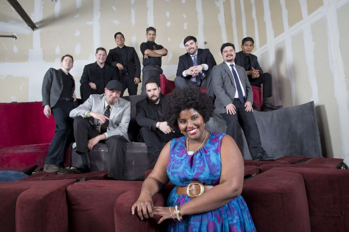 The band The Suffers poses for a group portrait before playing on Friday, December 19, 2014 at Warehouse Live in In Houston, TX. (For the Chronicle by Thomas B. Shea)