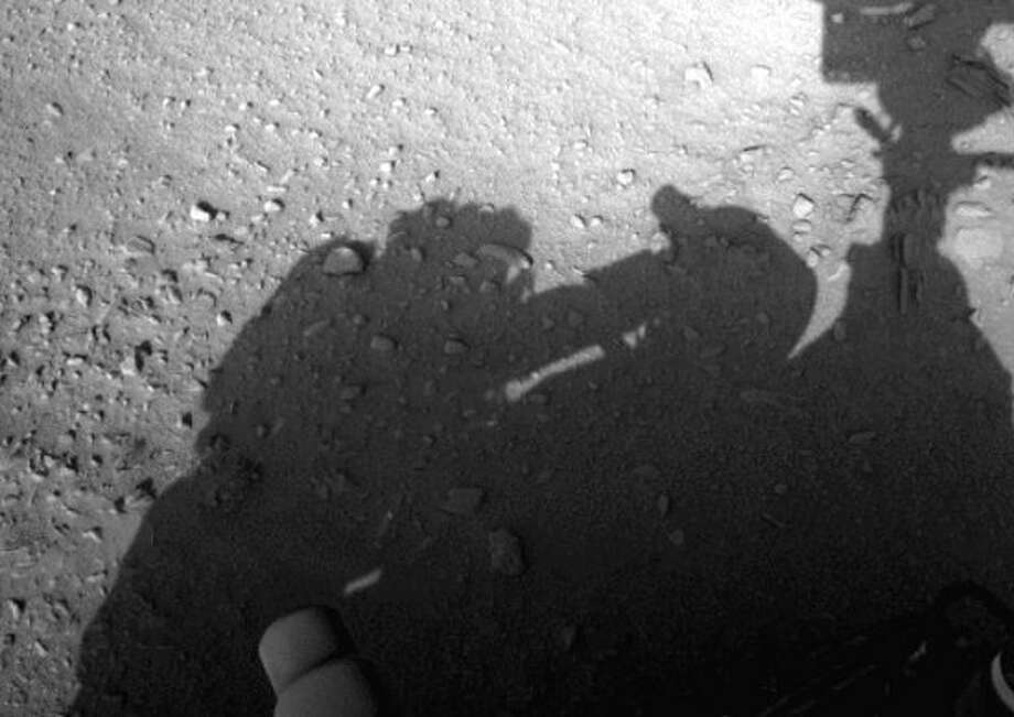 NASA doubters say this Mars rover photos casts a shadow that appears to show a man with an oxygen tank tinkering on the rover, hinting that either there is a mechanic on Mars or that the rover is actually home on Earth. Photo: NASA